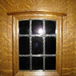 Leaded glass window in pocket door